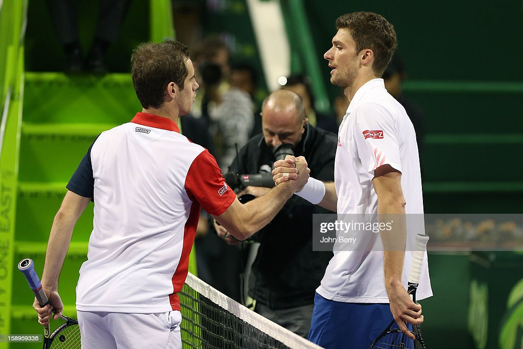 Richard Gasquet of France shakes hands with Daniel Brands of Germany after his semi-final victory in day five of the Qatar Open 2013 at the Khalifa International Tennis and Squash Complex on January 4, 2013 in Doha, Qatar.