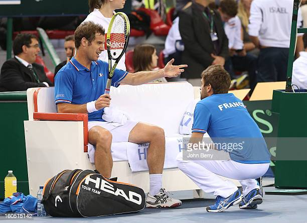 Richard Gasquet of France speaks to France coach Arnaud Clement during his match against Dudi Sela of Israel on day one of the Davis Cup first round...