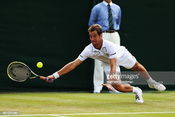 Richard Gasquet of France stretches to reach for a return shot during his Gentlemen's Singles second round match against Nick Kyrgios of Australia on...