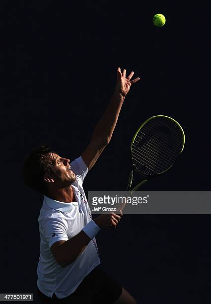Richard Gasquet of France tosses the ball up before serving to Teymuraz Gabashvili of Russia during the BNP Paribas Open at Indian Wells Tennis...