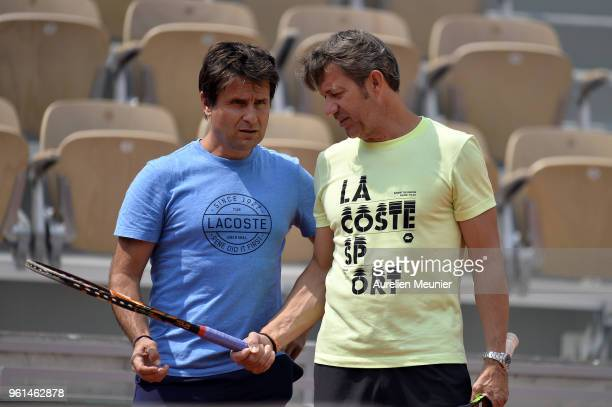 Richard Gasquet' s coache Fabrice Santoro and David Goffin's coach Thierry Van Cleemput speak during a practice session ahead of the French Open at...