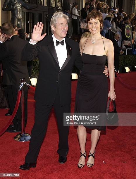Richard Gere and Carey Lowell during 9th Annual Screen Actors Guild Awards Arrivals at Shrine Exposition Center in Los Angeles California United...