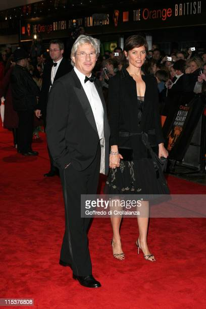 Richard Gere and Carey Lowell during BAFTA Film Awards 2005 Arrivals at The Odeon Leicester Square in London United Kingdom