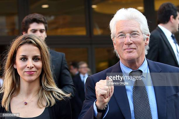 Richard Gere and his girlfriend Alejandra Silva leave at the end of 'Un Muro o Un Ponte' Seminary held by Pope Francis at the Paul VI Hall on May 29...