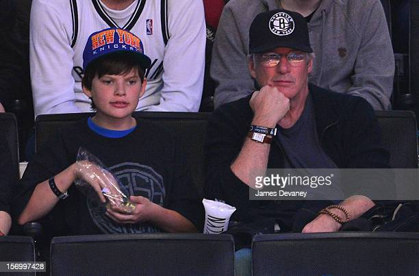 Richard Gere and son Homer attend the New York Knicks v Brooklyn Nets game at Barclays Center on November 26, 2012 in the Brooklyn borough of New...