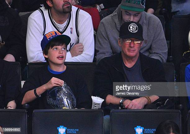 Richard Gere and son Homer James attend the New York Knicks vs Brooklyn Nets game at Barclays Center on November 26 2012 in the Brooklyn borough of...