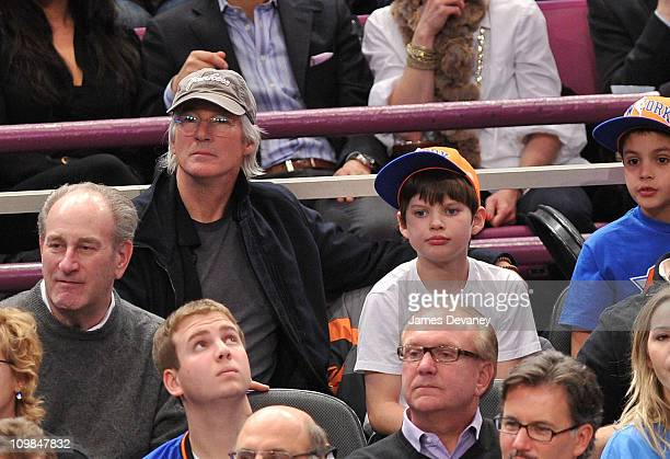 Richard Gere and son Homer James Jigme Gere attend the Utah Jazz vs New York Knicks game at Madison Square Garden on March 7 2011 in New York City