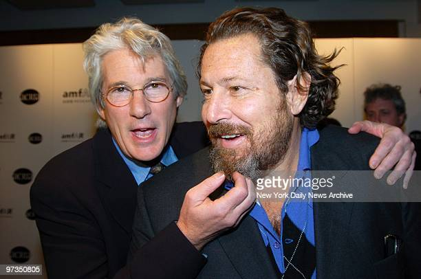 Richard Gere tickles the beard of artist Julian Schnabel during a benefit at Sotheby's to posthumously recognize photographer Herb Ritts for his work...