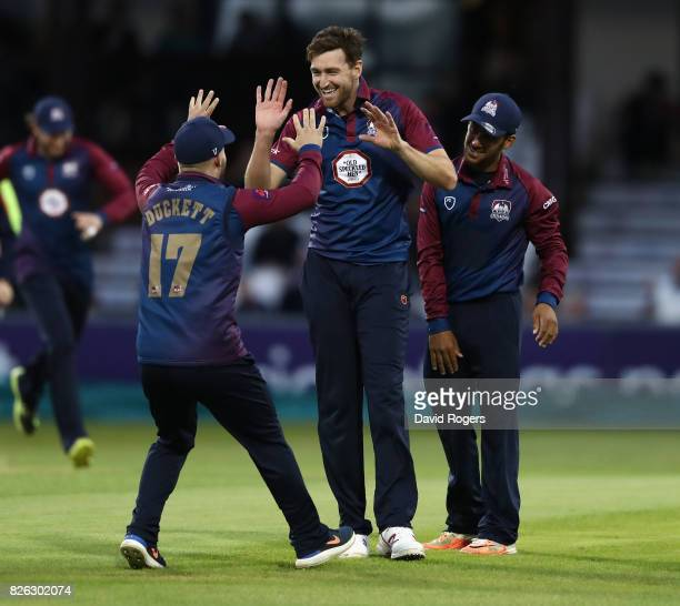 Richard Gleeson of Northamptonshire celebrates with team mate Ben Duckett after bowling Jos Buttler during the NatWest T20 Blast match between...