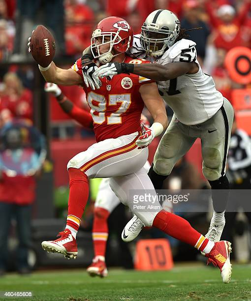 Richard Gordon of the Kansas City Chiefs scores a touchdown against RayRay Armstrong of the Oakland Raiders in the third quarter at Arrowhead Stadium...