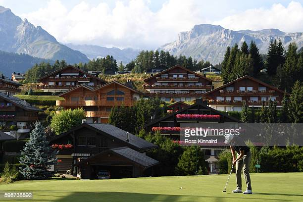 Richard Green of Australia holes a birdie putt on the 14th green during the second round of the Omega European Masters at CranssurSierre Golf Club on...