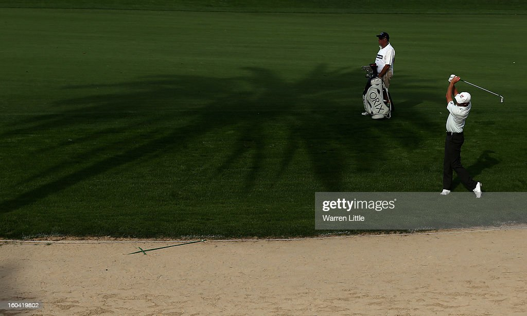 Richard Green of Australia plays his second shot into the eighth green during the first round of the Omega Dubai Desert Classic at Emirates Golf Club on January 31, 2013 in Dubai, United Arab Emirates.