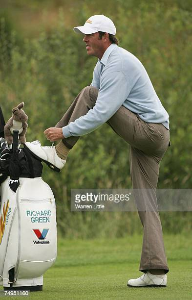 Richard Green of Australia ties his shoe laces on the eighth hole during the second round of The Open de France ALSTOM at the Le Golf National Golf...