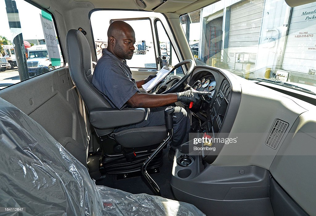 Richard Guignard, a diesel technician conducts a pre-delivery check on a Navistar Inc. International Truck ProStar tractor, at Rechtien International Trucks Inc., in Miami, Florida, U.S. on Friday, Oct. 12, 2012. The U.S. Census Bureau is scheduled to release business inventories figures on Oct. 15. Photographer: Mark Elias/Bloomberg via Getty Images