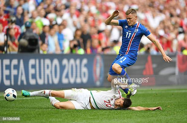 Richard Guzmics of Hungary tackles Alfred Finnbogason of Iceland during the UEFA EURO 2016 Group F match between Iceland and Hungary at Stade...