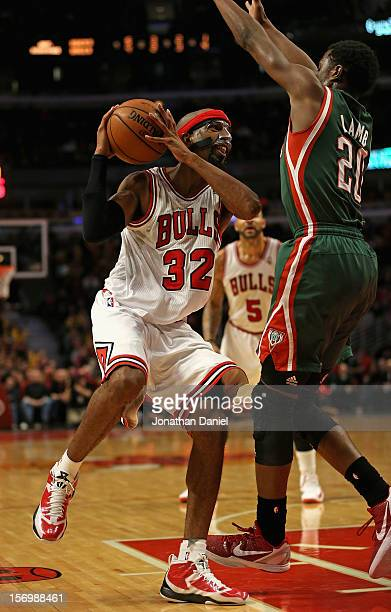 Richard Hamilton of the Chicago Bulls drives against Doron Lamb of the Milwaukee Bucks on his way to a gamehigh 30 points at the United Center on...