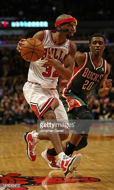 Richard Hamilton of the Chicago Bulls drives against Doron Lamb of the Milwaukee Bucks at the United Center on November 26 2012 in Chicago Illinois...