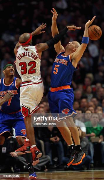 Richard Hamilton of the Chicago Bulls passes the ball between the arms of Jason Kidd of the New York Knicks at the United Center on April 11 2013 in...