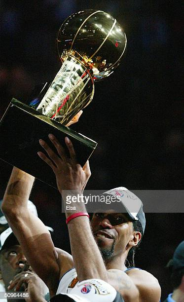 Richard Hamilton of the Detroit Pistons celebrates with the Larry O'Brien NBA Championship trophy after defeating the Los Angeles Lakers 10087 in...