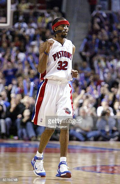 Richard Hamilton of the Detroit Pistons clenches his fist after making a basket against the Philadelphia 76ers late in Game five of the Eastern...
