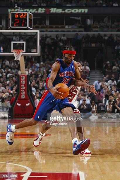 Richard Hamilton of the Detroit Pistons dribbles the ball as Chris Duhon of the Chicago Bulls guards on April 11 2005 at the United Center in Chicago...