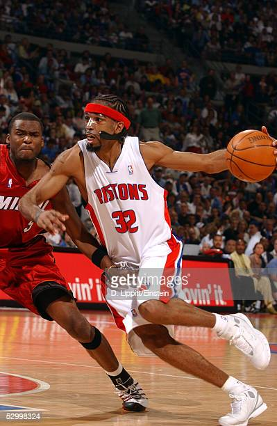 Richard Hamilton of the Detroit Pistons drives against Keyon Dooling of the Miami Heat in Game three of the Eastern Conference Finals during the 2005...
