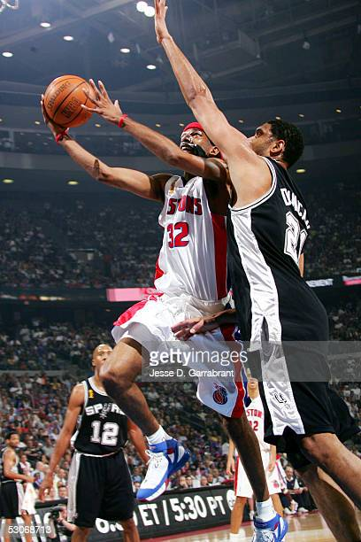 Richard Hamilton of the Detroit Pistons drives against Tim Duncan of the San Antonio Spurs in Game three of the 2005 NBA Finals on June 14, 2005 at...