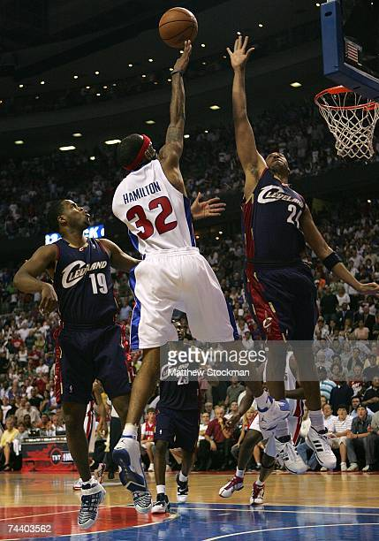 Richard Hamilton of the Detroit Pistons drives for a shot attempt against Damon Jones and Donyell Marshall of the Cleveland Cavaliers in Game Five of...