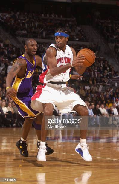 Richard Hamilton of the Detroit Pistons drives on Kobe Bryant of the Los Angeles Lakers during NBA action November 18, 2003 at the Palace of Auburn...