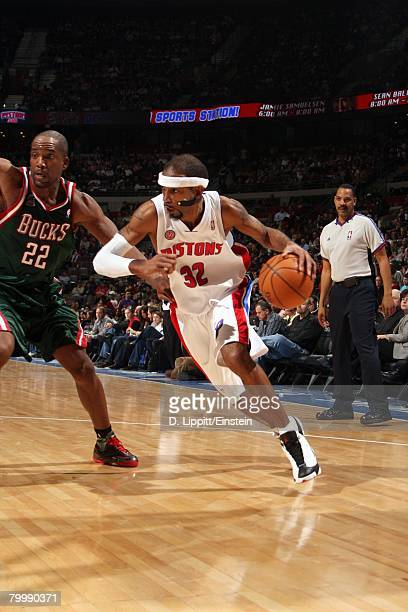 Richard Hamilton of the Detroit Pistons drives to the basket against Michael Redd of the Milwaukee Bucks during the game at the Palace of Auburn...