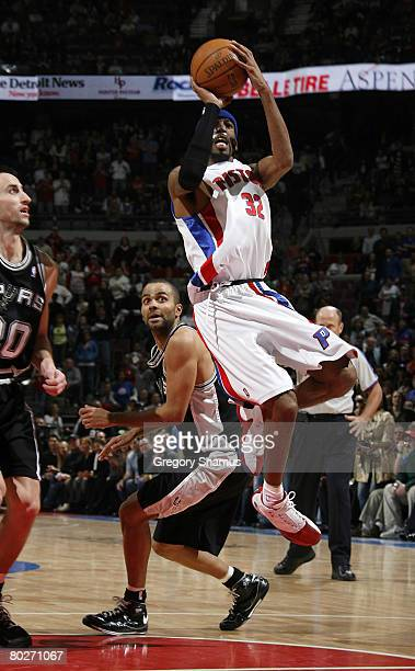 Richard Hamilton of the Detroit Pistons gets a shot off in front of Tony Parker of the San Antonio Spurs on March 14 2008 at the Palace of Auburn...
