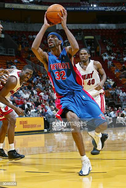 Richard Hamilton of the Detroit Pistons goes to the basket against the Miami Heat during the game at American Airlines Arena on February 2 2004 in...