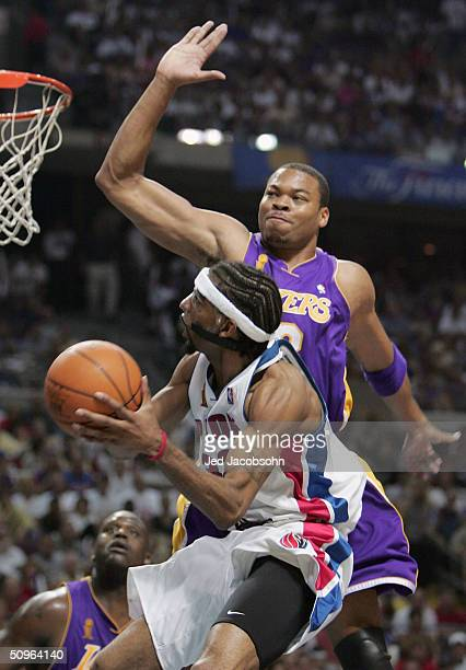 Richard Hamilton of the Detroit Pistons goes to the basket against Devean George of the Los Angeles Lakers in the second half of game five of the...