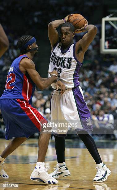 Richard Hamilton of the Detroit Pistons guards Michael Redd of the Milwaukee Bucks in game three of the Eastern Conference Quarterfinals during the...