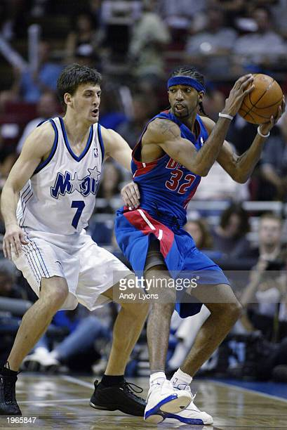 Richard Hamilton of the Detroit Pistons is defended by Gordan Giricek of the Orlando Magic in Game three of the Eastern Conference Quarterfinals...