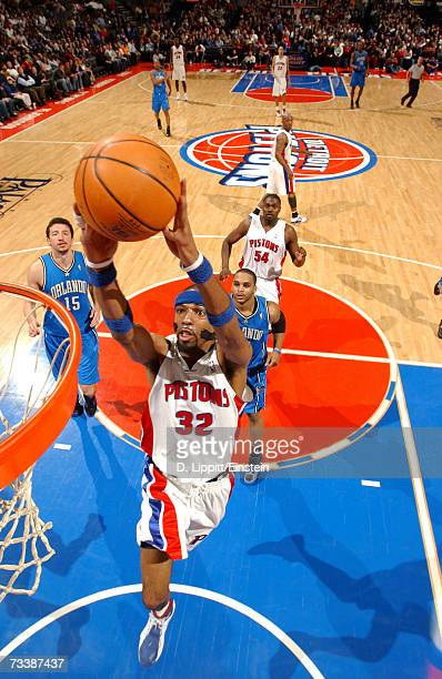 Richard Hamilton of the Detroit Pistons lays up past Jameer Nelson of the Orlando Magic during a game on February 21, 2007 at the Palace of Auburn...