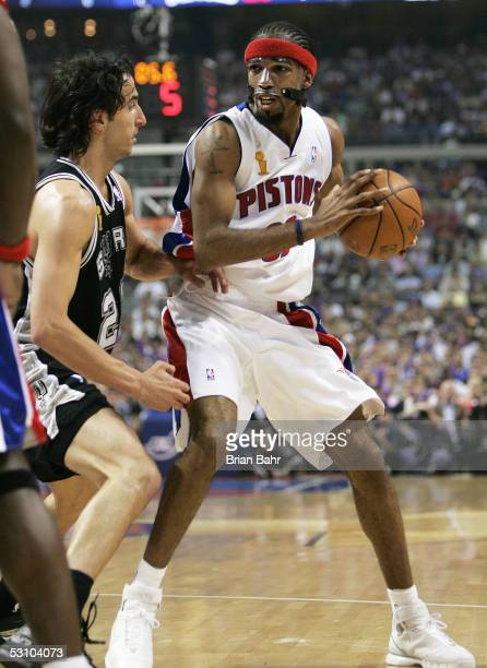 Richard Hamilton of the Detroit Pistons looks for an opening in the first half against Manu Ginobili of the San Antonio Spurs in Game five of the...