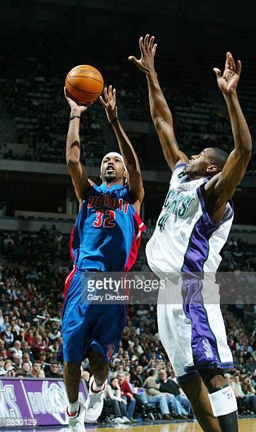 Richard Hamilton of the Detroit Pistons shoots a jump shot beyond the reach of Desmond Mason of the Milwaukee Bucks during the game December 23 2003...