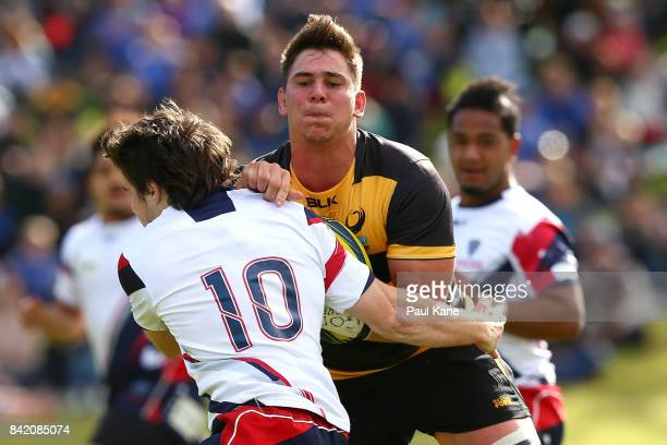 Richard Hardwick gets tackled by Jack McGregor of the Rising during the round one NRC match between Perth Spirit and Melbourne Rising at McGillivray...