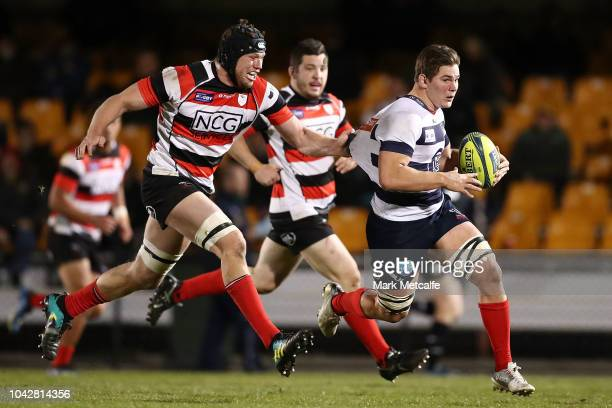 Richard Hardwick of Melbourne Rising is tackled during the round five NRC match between Canberra Vikings and Melbourne Rising at Viking Park on...