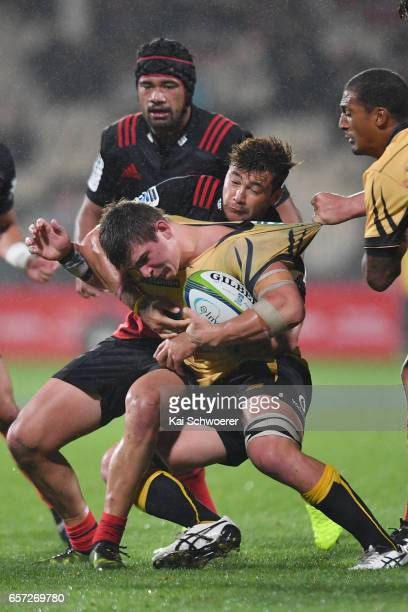 Richard Hardwick of the Force is tackled by David Havili of the Crusaders and Jordan Taufua of the Crusaders during the round five Super Rugby match...