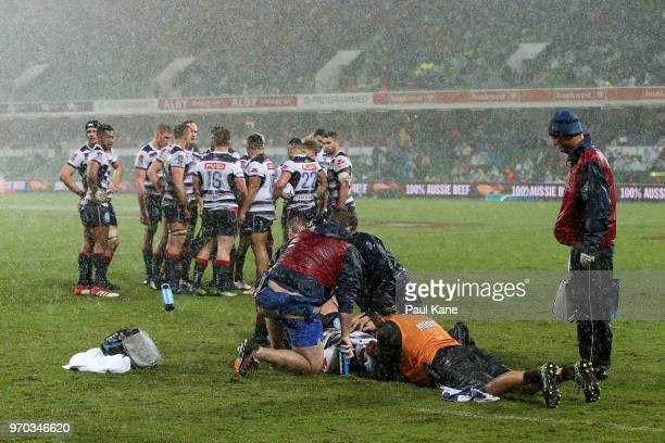 Richard Hardwick of the Rebels is attended to by medical staff during the World Series Rugby match between the Force and the Rebels at nib Stadium on...