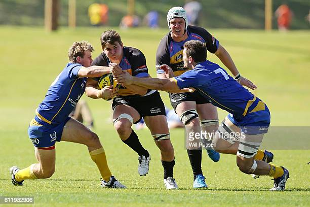 Richard Hardwick of the Spirit is tackled during the round six NRC match between the Perth Spirit and Brisbane City at UWA Sports Park on October 2...