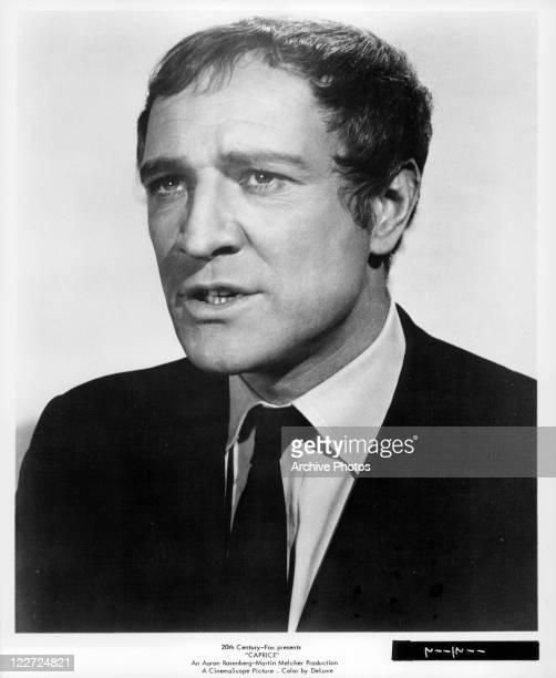 Richard Harris wearing tie and looking forward in a scene from the film 'Caprice' 1967