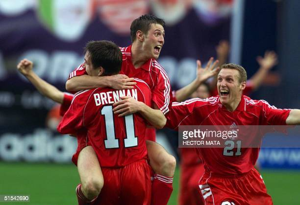 Richard Hastings from Canada celebrates his winning goal with teammates James Brennan and Martin Nash in the Gold Cup quarterfinals at Qualcomm...