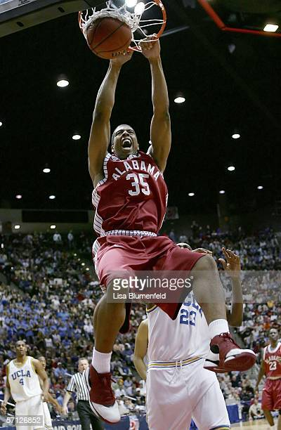 Richard Hendrix of the Alabama Crimson Tide slam dunks the ball against the UCLA Bruins during the second round of the NCAA National Championship on...