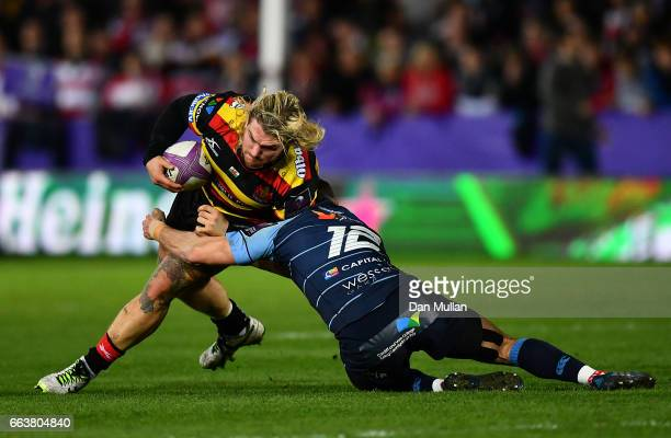 Richard Hibbard of Gloucester is tackled by Steven Shingler of Cardiff Blues during the European Rugby Challenge Cup quarter final match between...