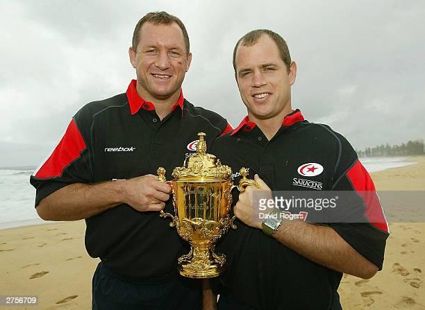 Richard Hill and Kyran Bracken of Saracens hold the William Webb Ellis Trophy wearing their Zurich Premiership shirts pose on November 24 2003 in...