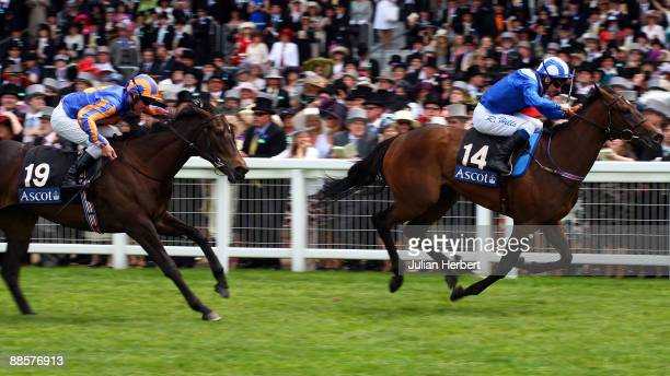 Richard Hills and Habaayib lead the Seamus Heefferman ridden Lillie Langtry home to land The Albany Stakes race run on The 4th Day of The Royal...