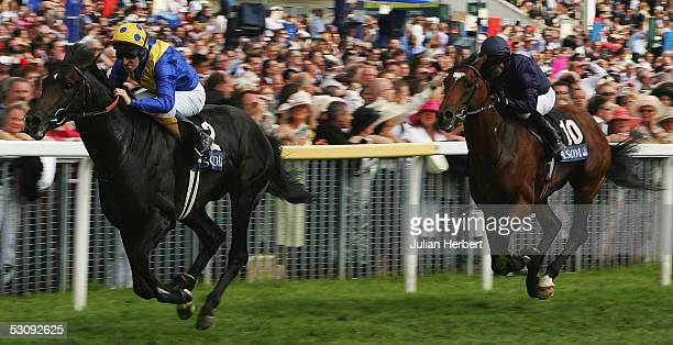 Richard Hills and Imperial Stride lead the Kieren Fallon ridden Mullins Bay home to land The Wolferton Handicap Stakes Race run at York Racecourse on...